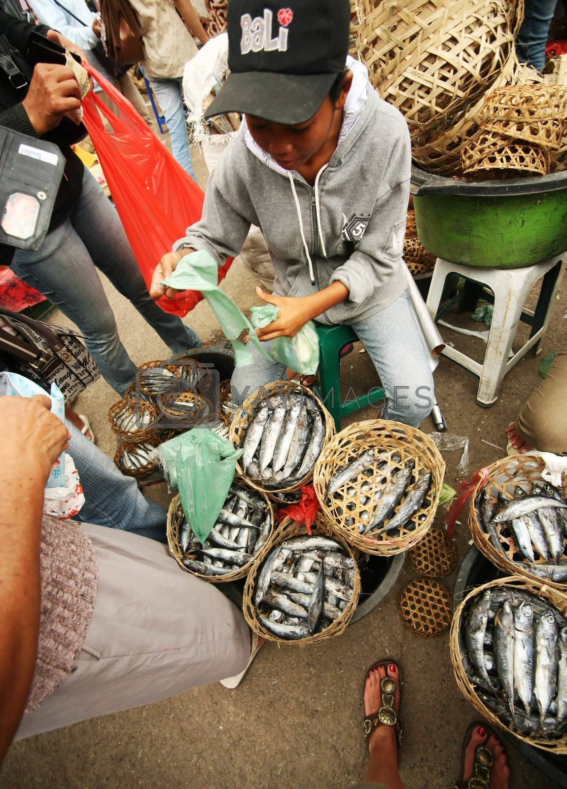 The Indonesian woman selling a fish