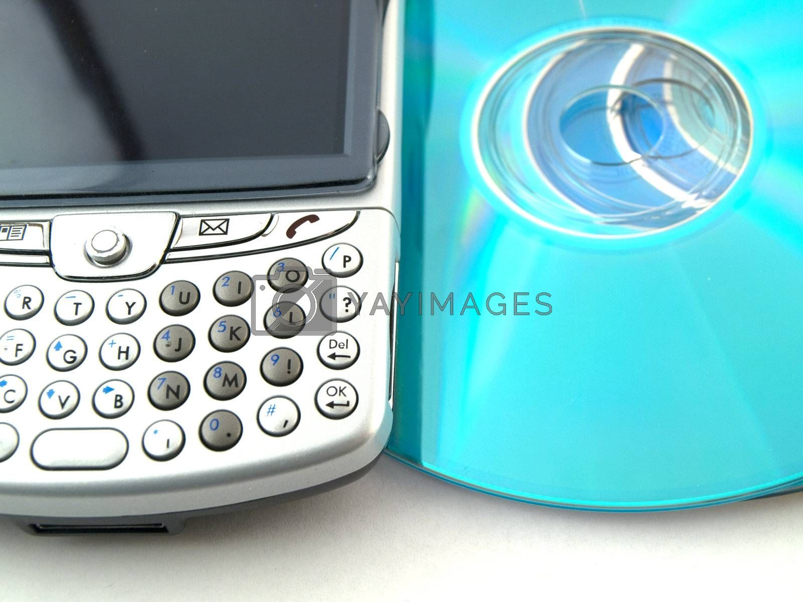 CDs DVDs and Mobile Phone PDA on White Background