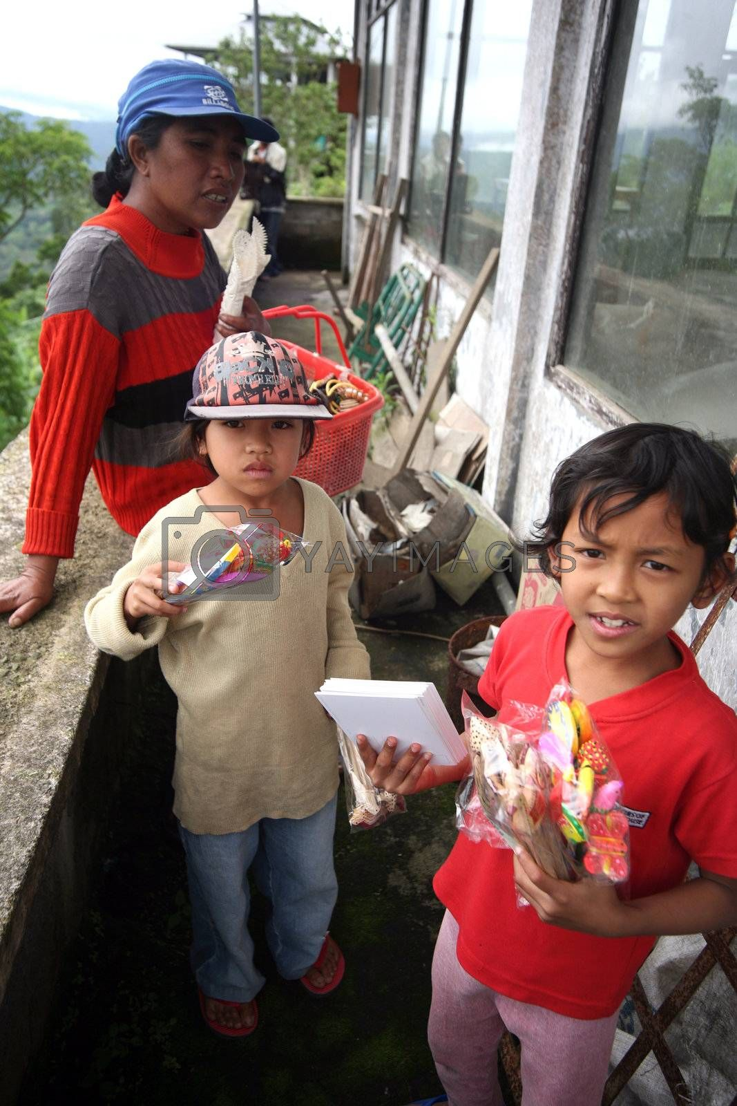 Mother and children selling souvenirs. Bali. Inonesia