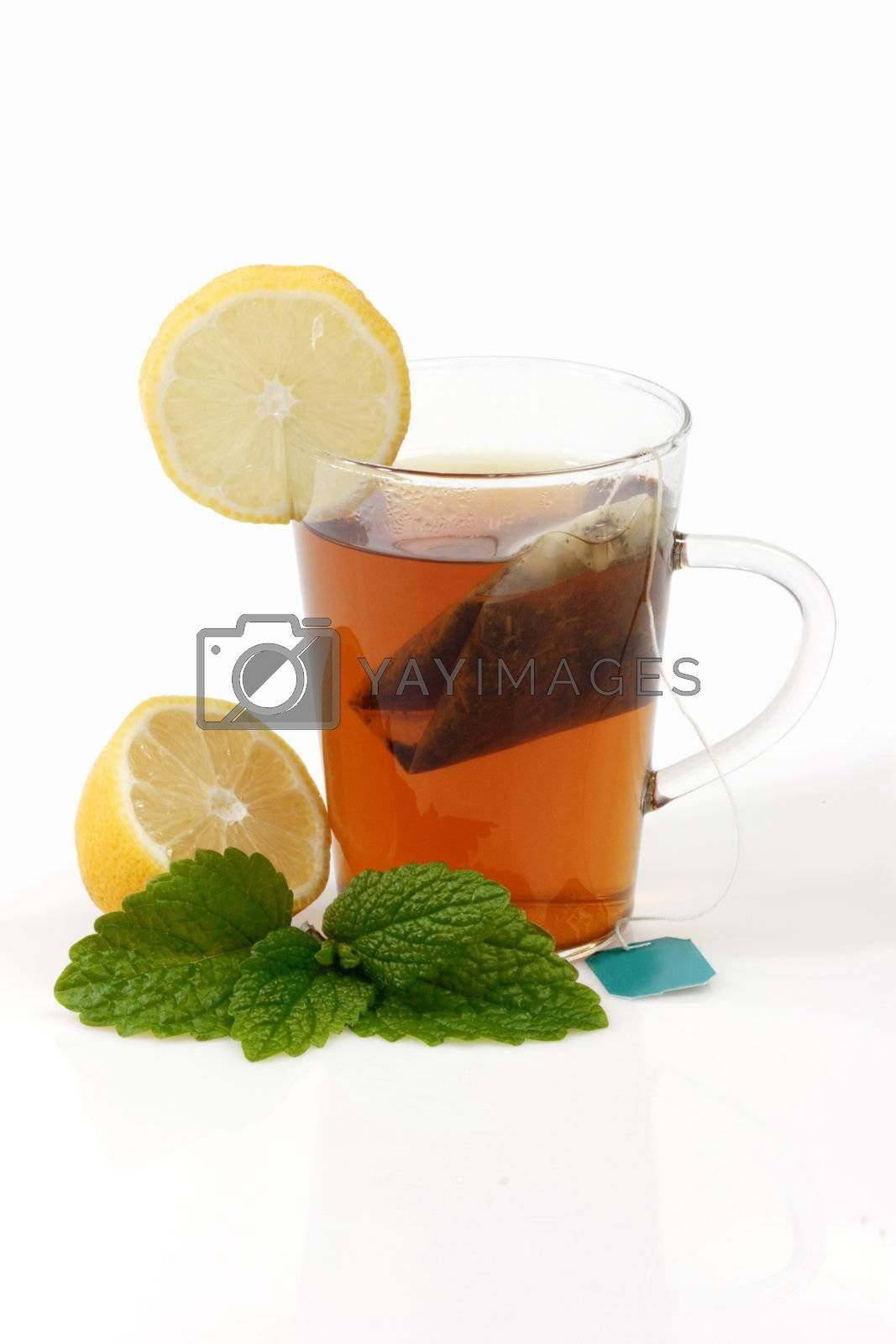 Peppermint tea in a glass - isolated on white background