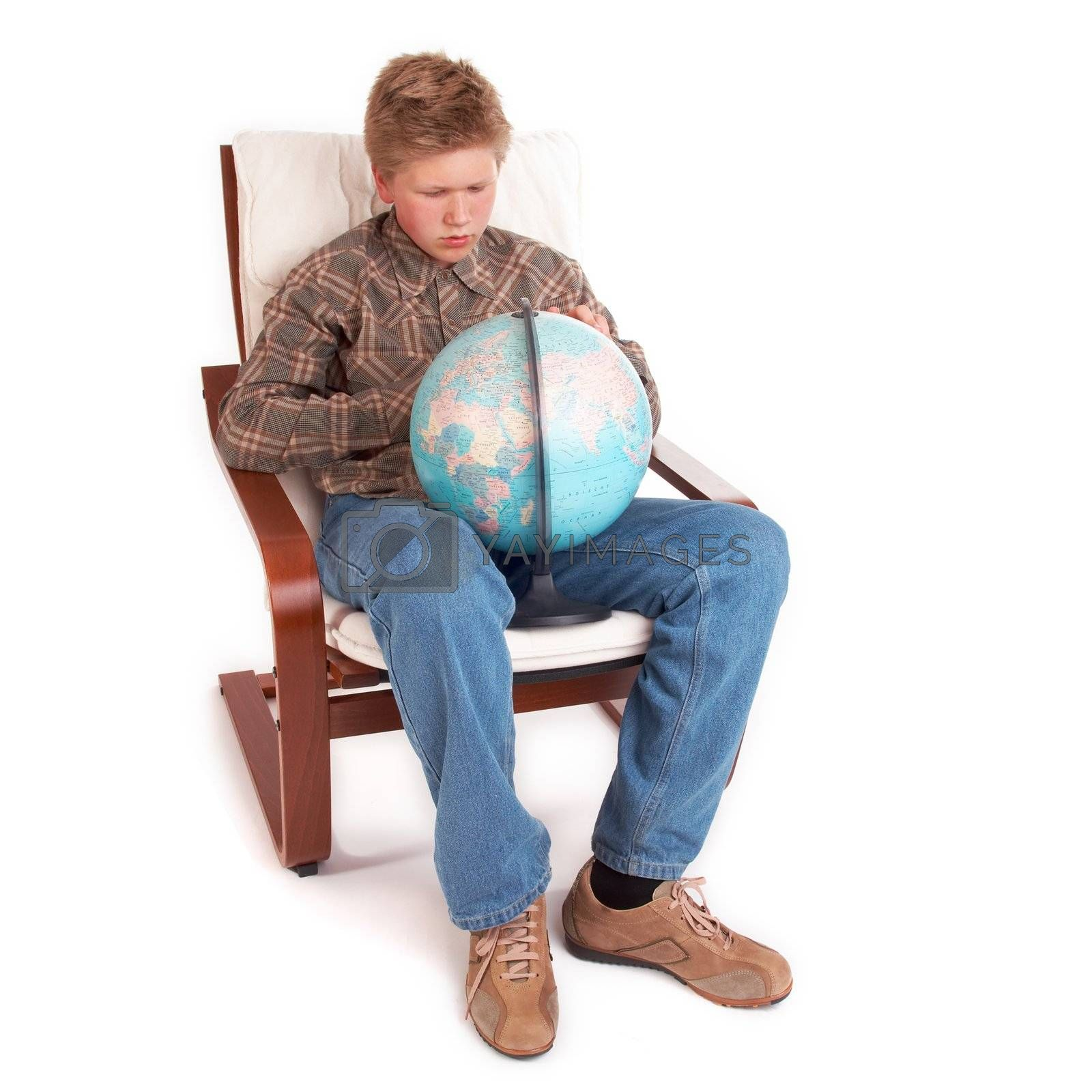 Blond teenager boy sitting with globe; isolated on white