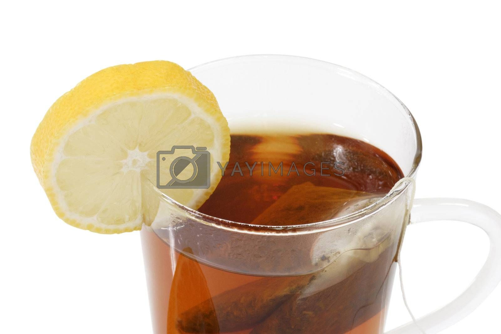 Tee in a glass with a lemon slice - isolated on white background
