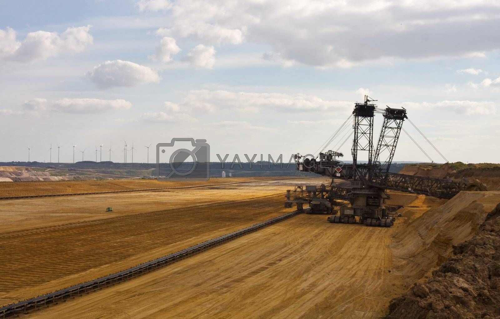 Giant bucket wheel excavator taking away the layers of ground before digging the brown coal.