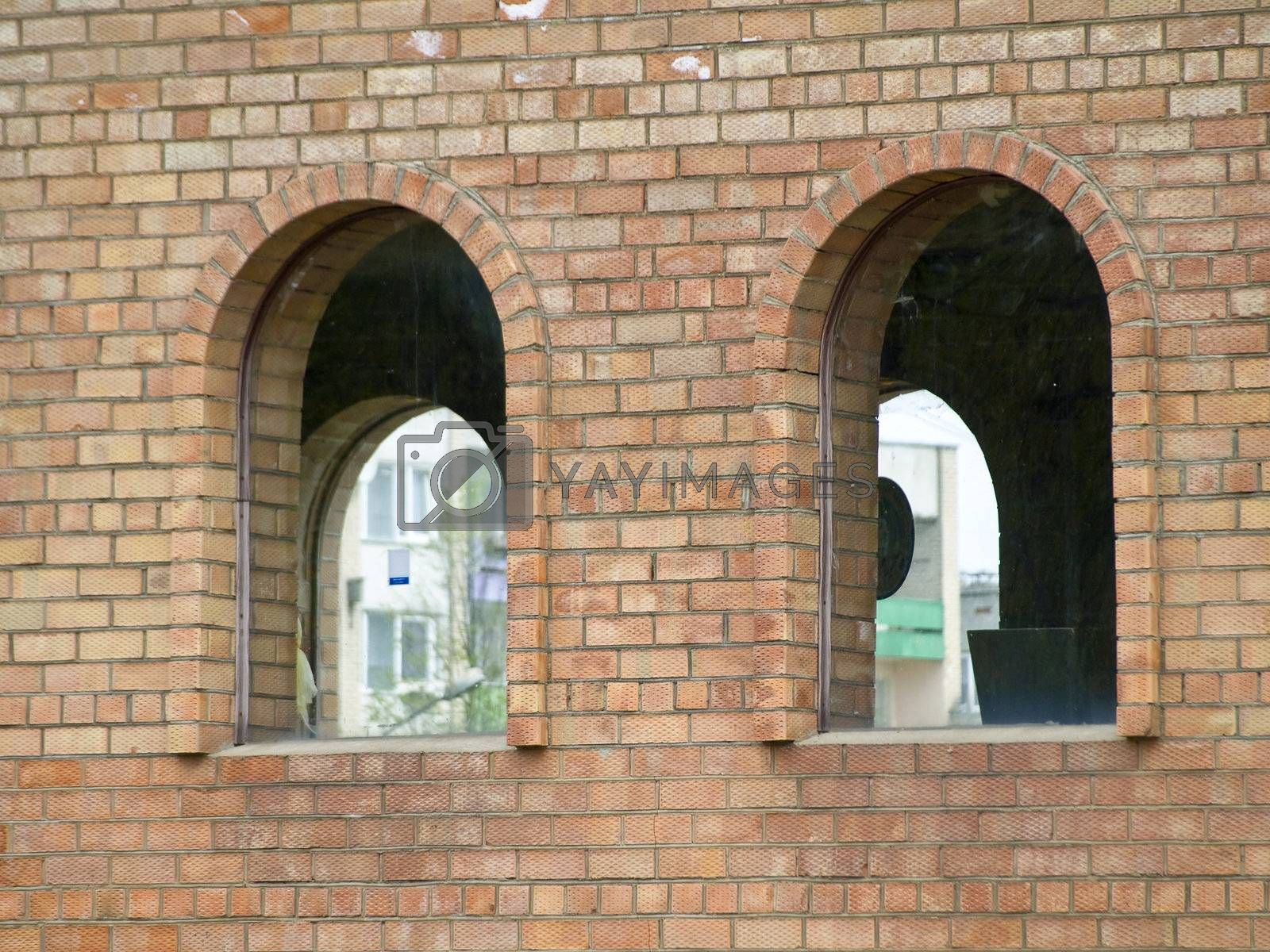 Two arcs at the bricks wall of the modern building