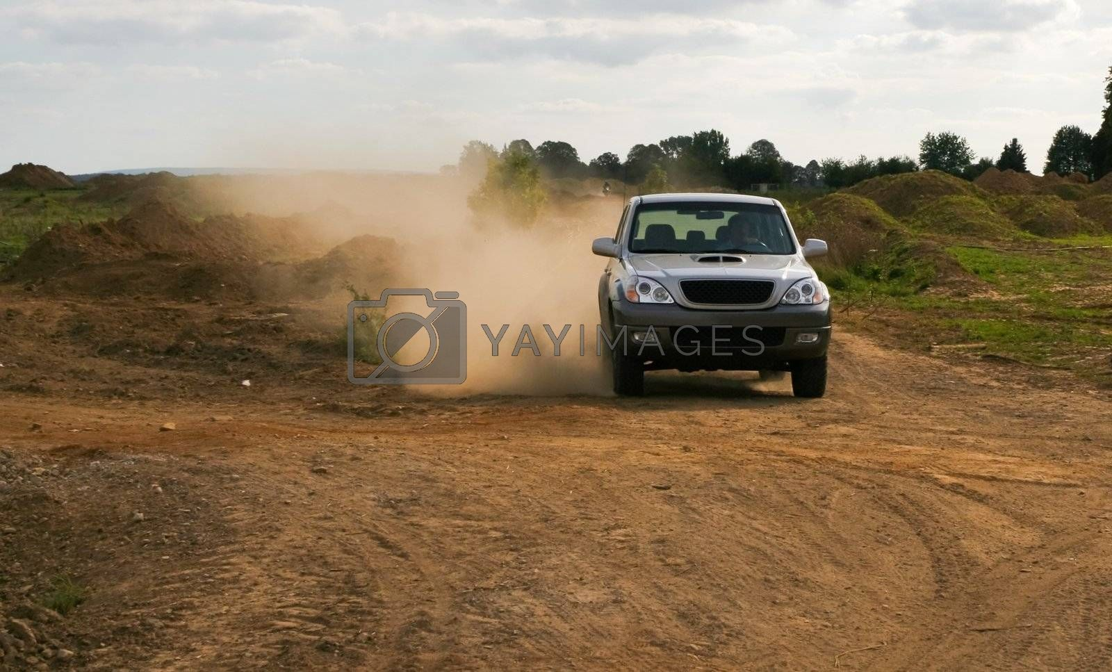 offroad car moving in the clouds of dust