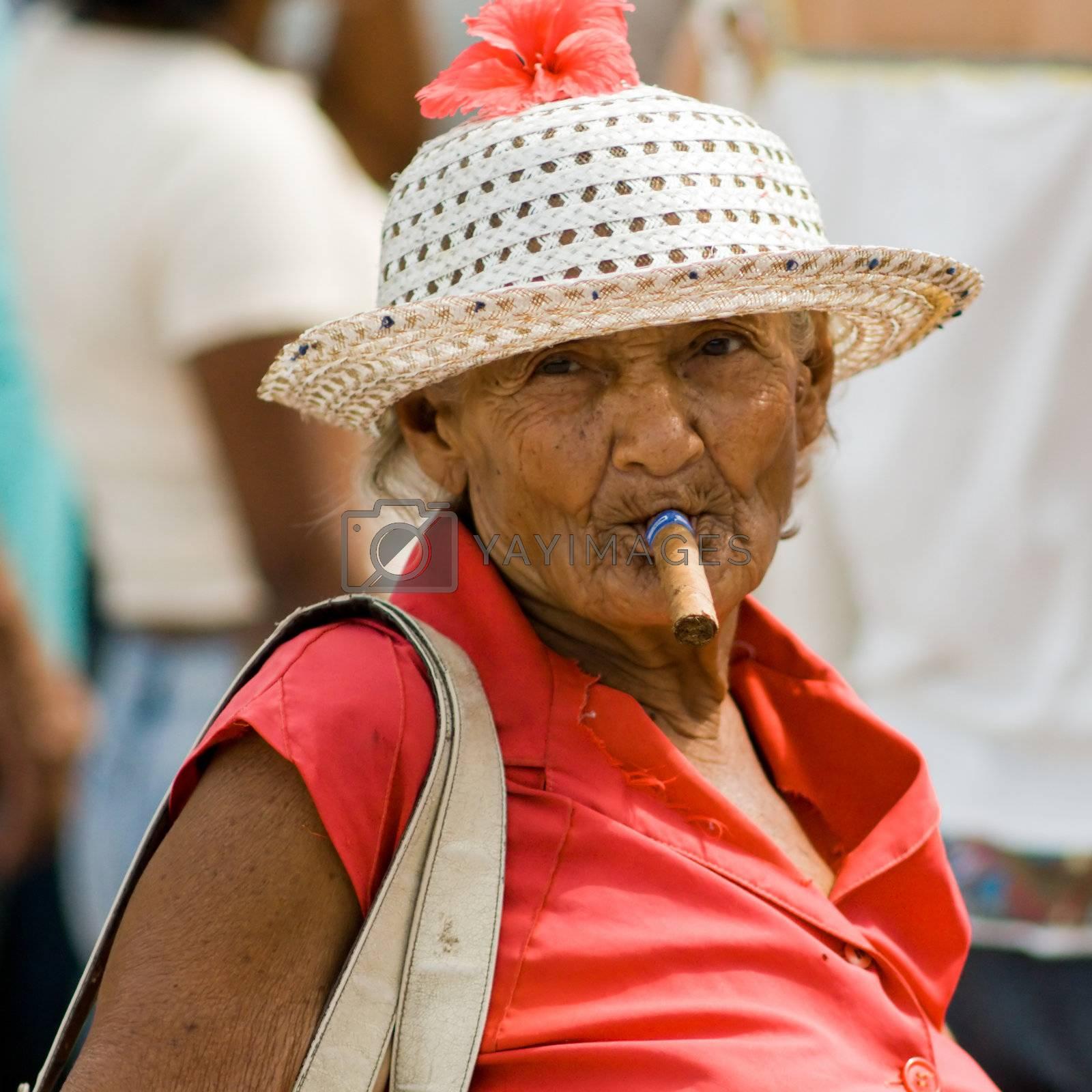 Old wrinkled woman smoking cigar. January 2008, Santiago-de-Cuba.