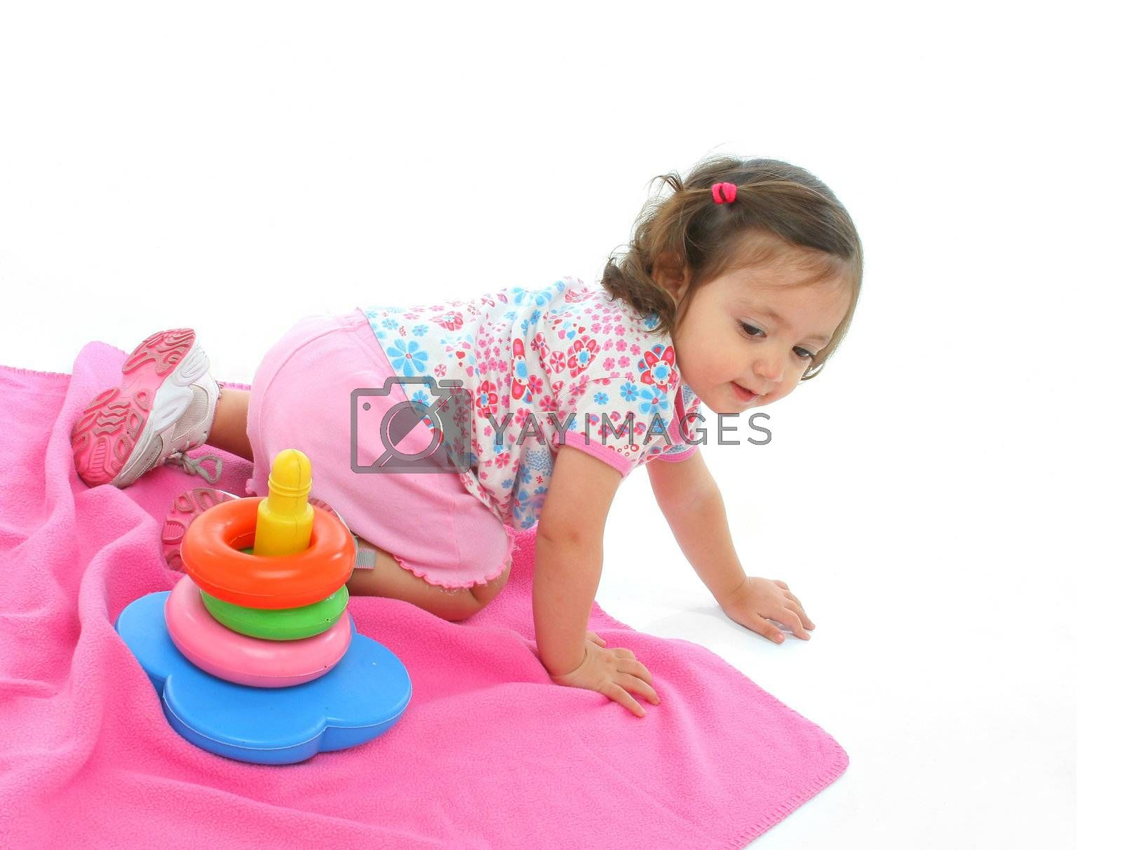 Little girl playing and having fun with generic toy. More pictures of this baby at my gallery