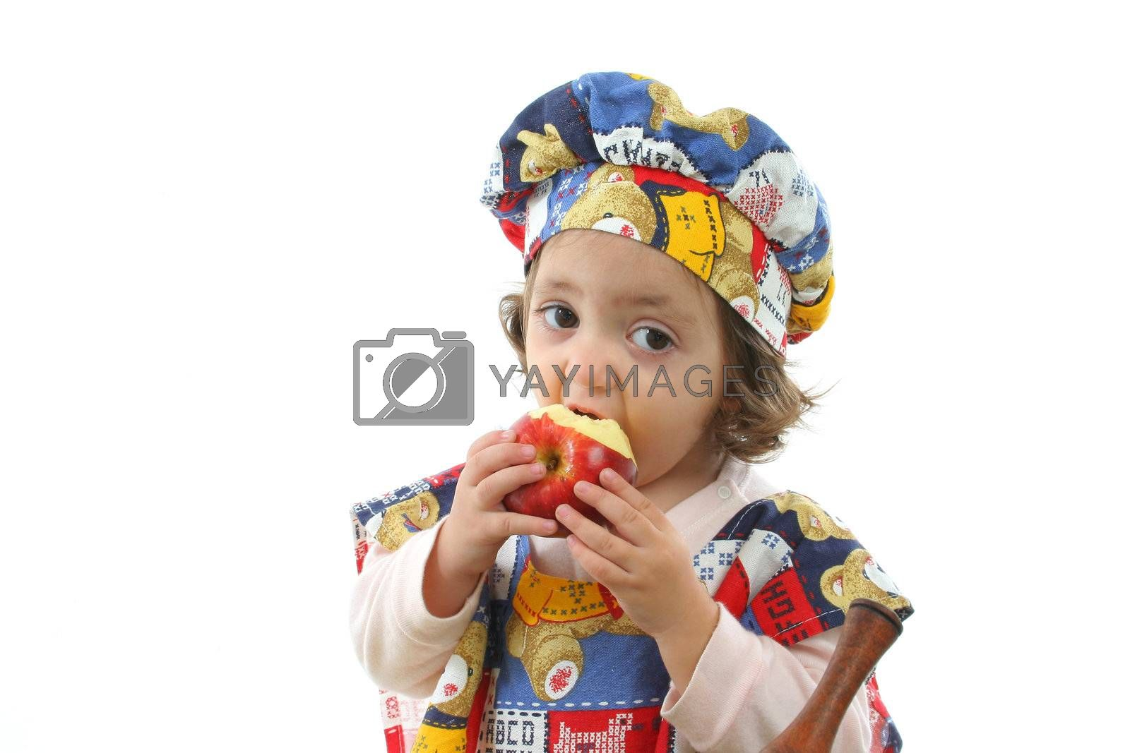 Cute toddler eating an apple dressed at a cheff. More pictures of this baby at my gallery