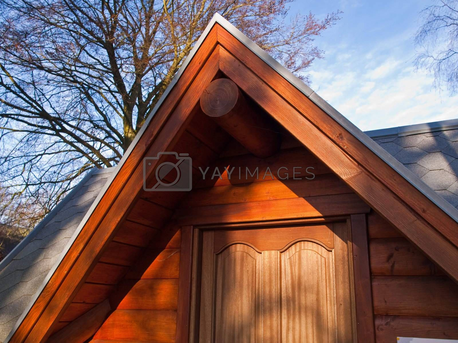 Details of a Swiss Alps winter wooden chalet cabin