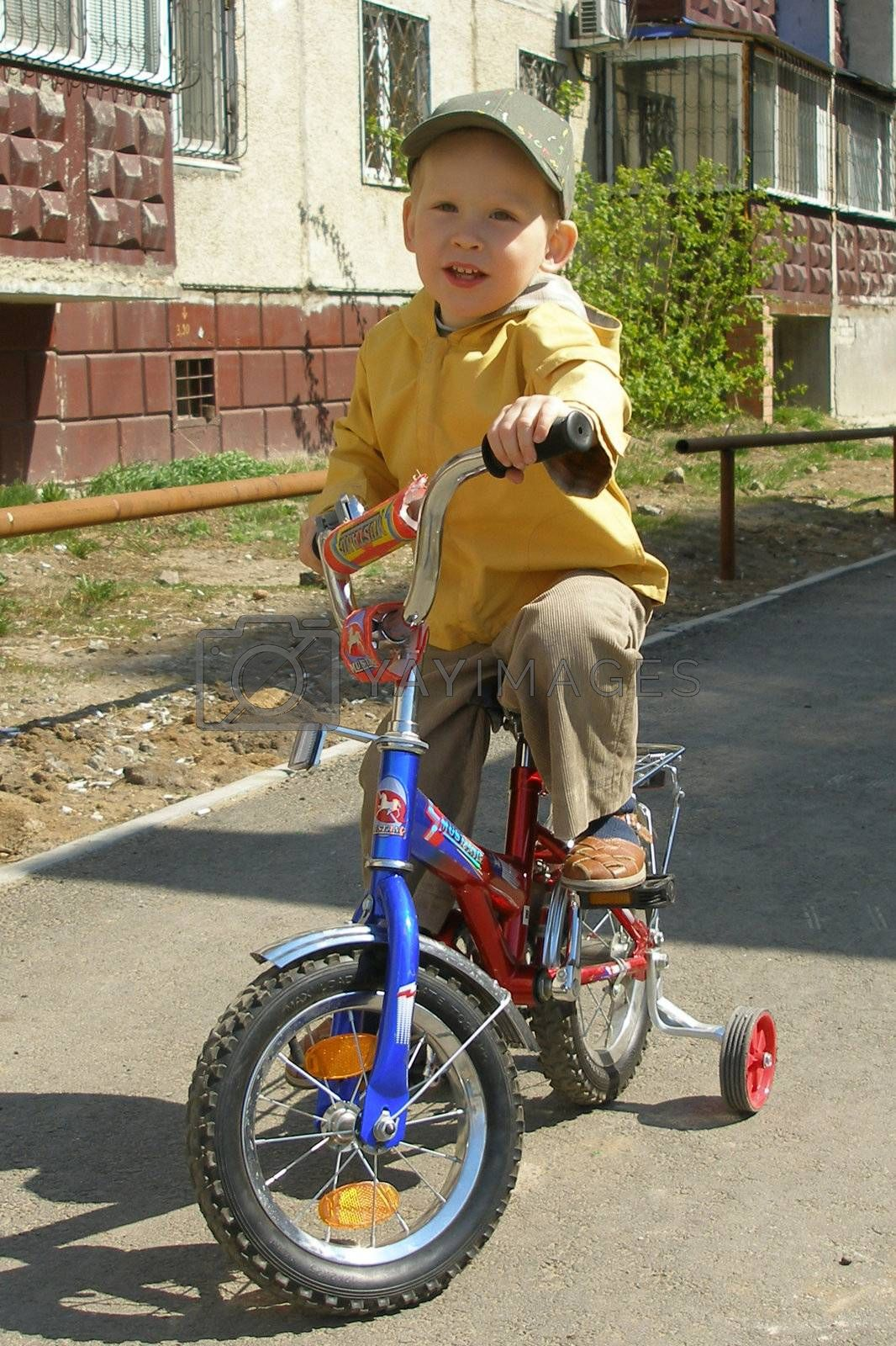 The boy goes for a drive on a bicycle