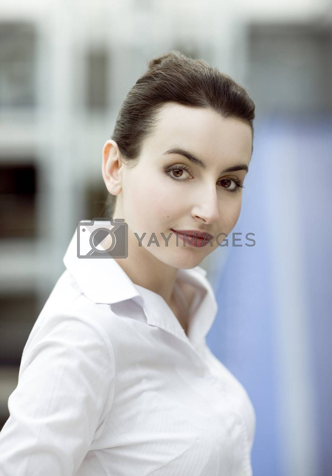 Portrait of young woman in modern office building environment