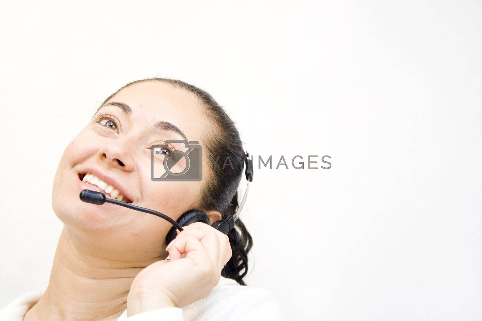 Happy young woman on headset telephone smiling