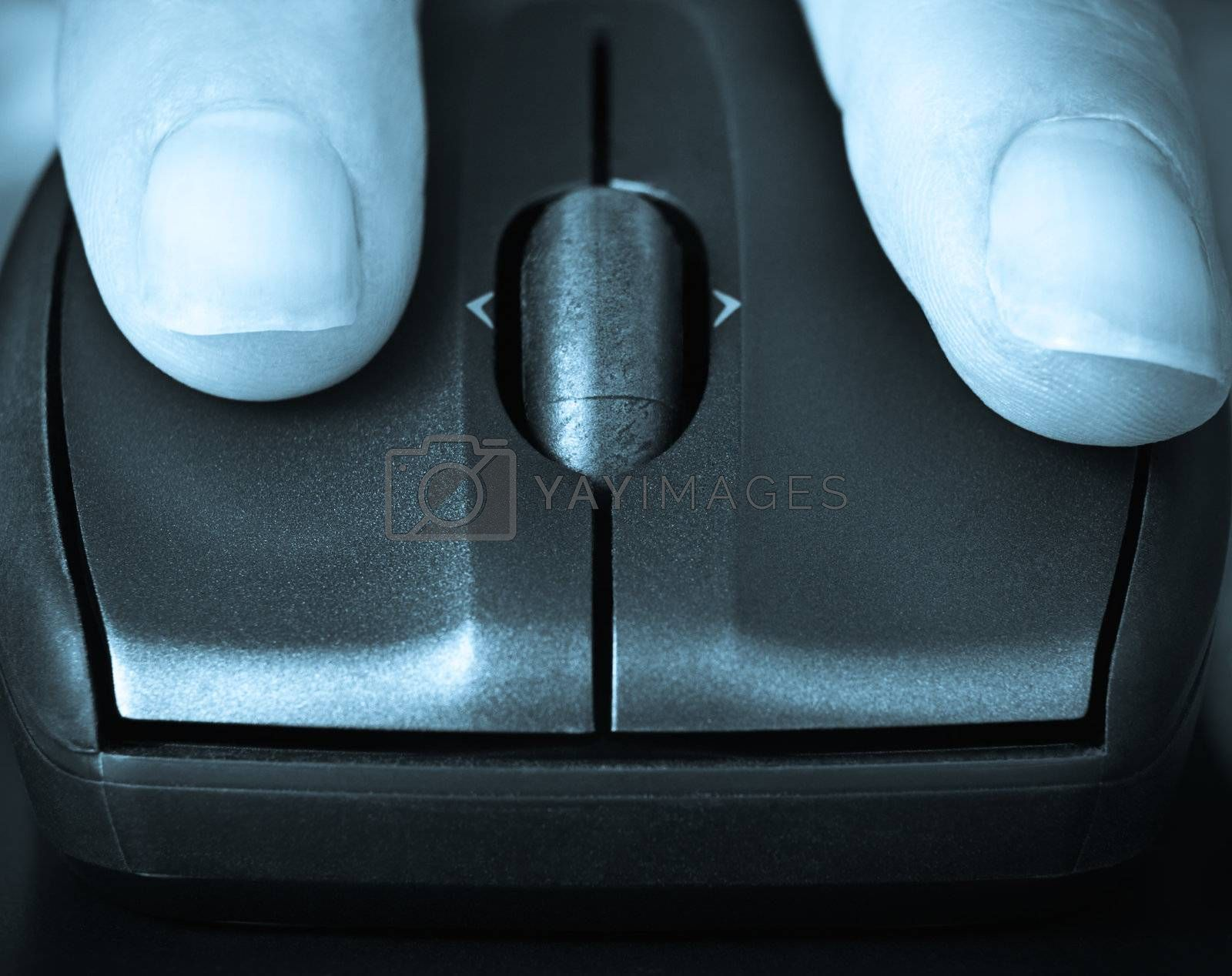 closeup of fingers on a computer mouse clicking,suggesting searching or informing, blue toned