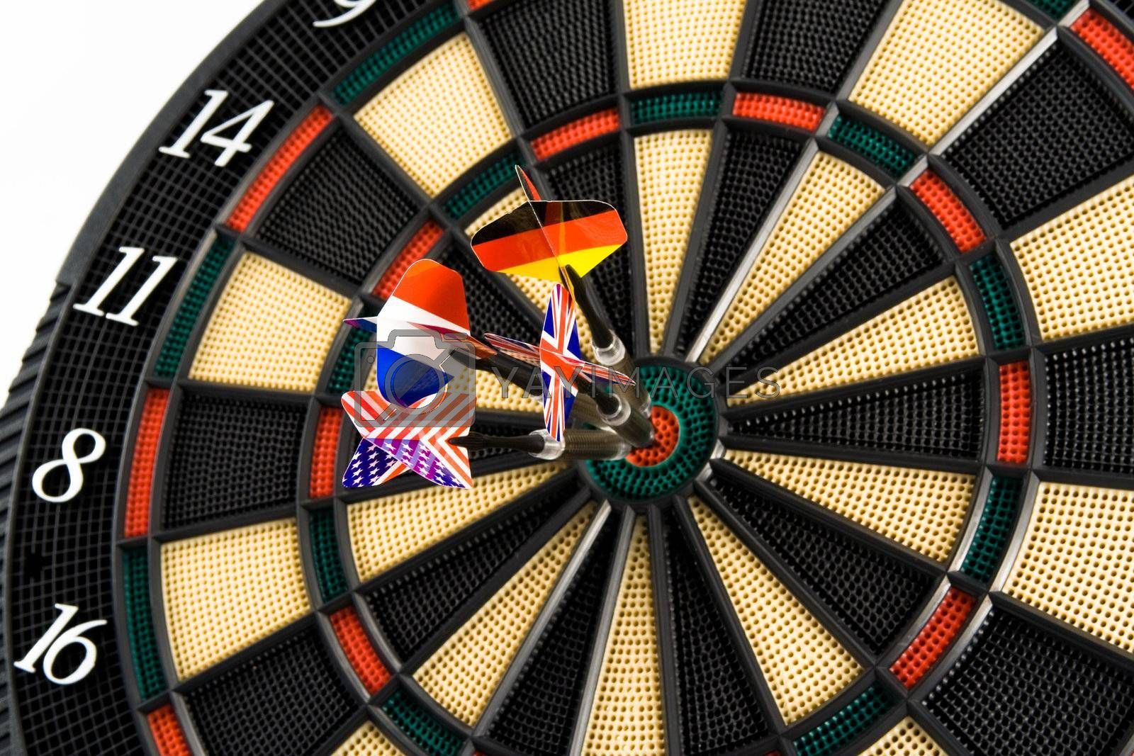 Four darts in center of target. Isolated.
