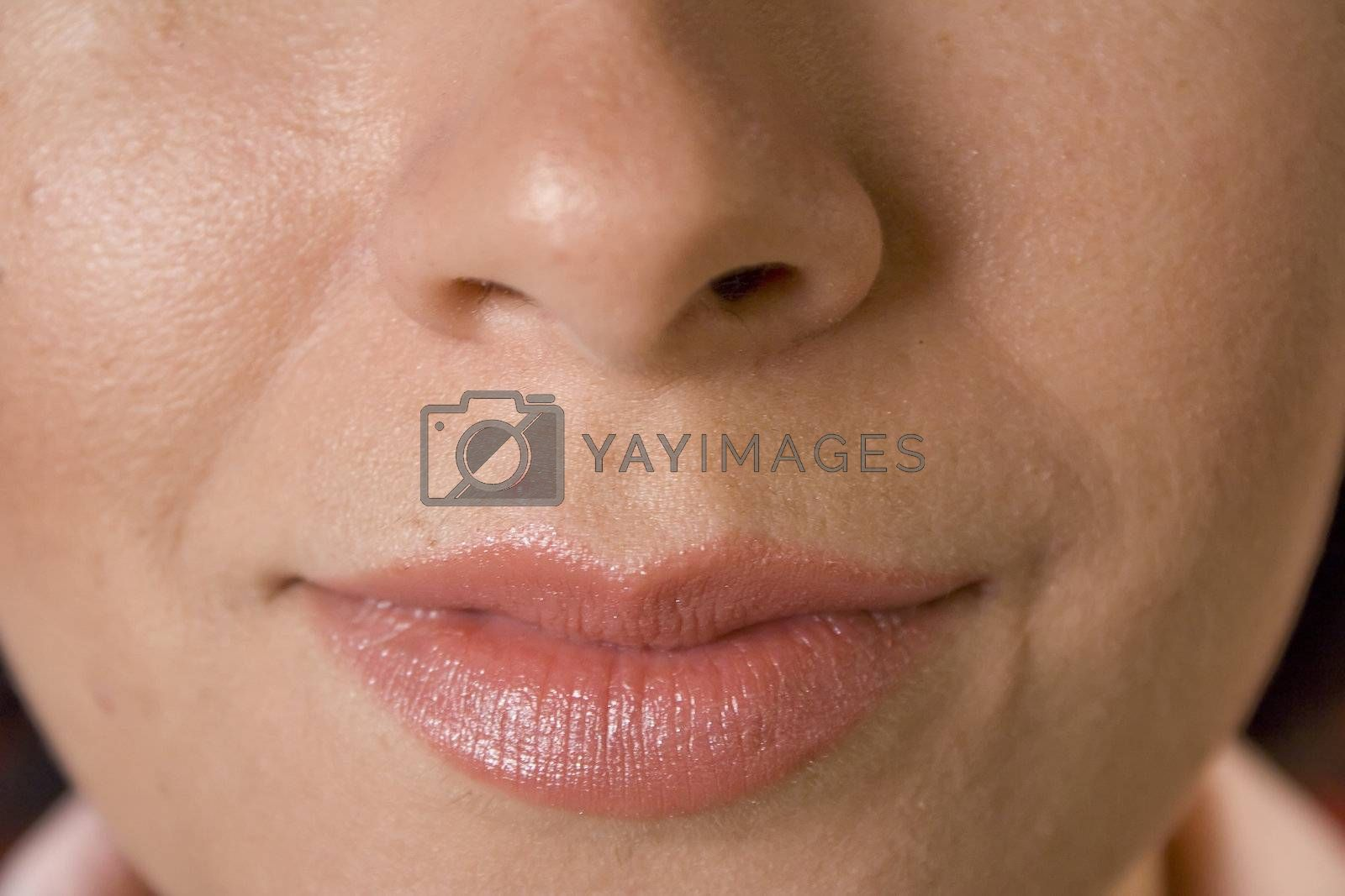 Close up of womans face with lips and nose
