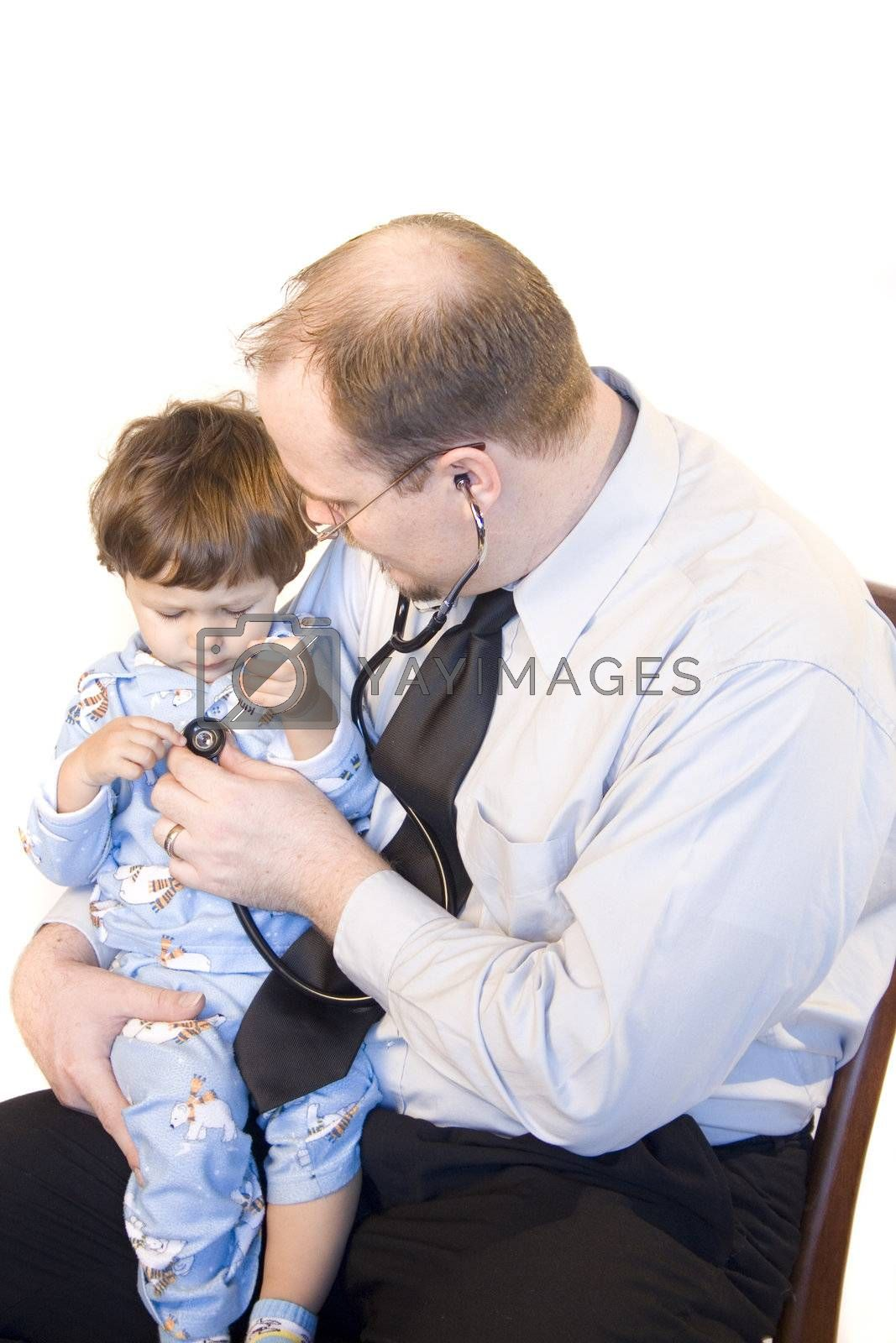 Doctor sitting with young child giving checkup