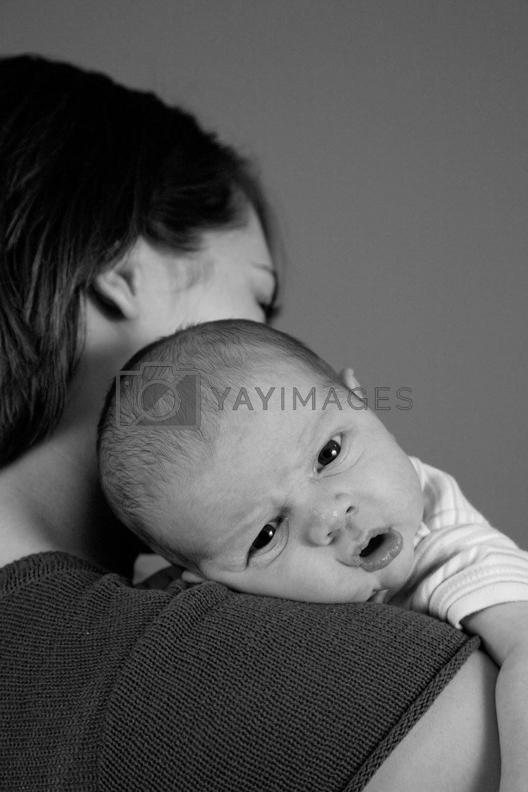 A portrait of a newborn baby boy and his mother. Ten days old.
