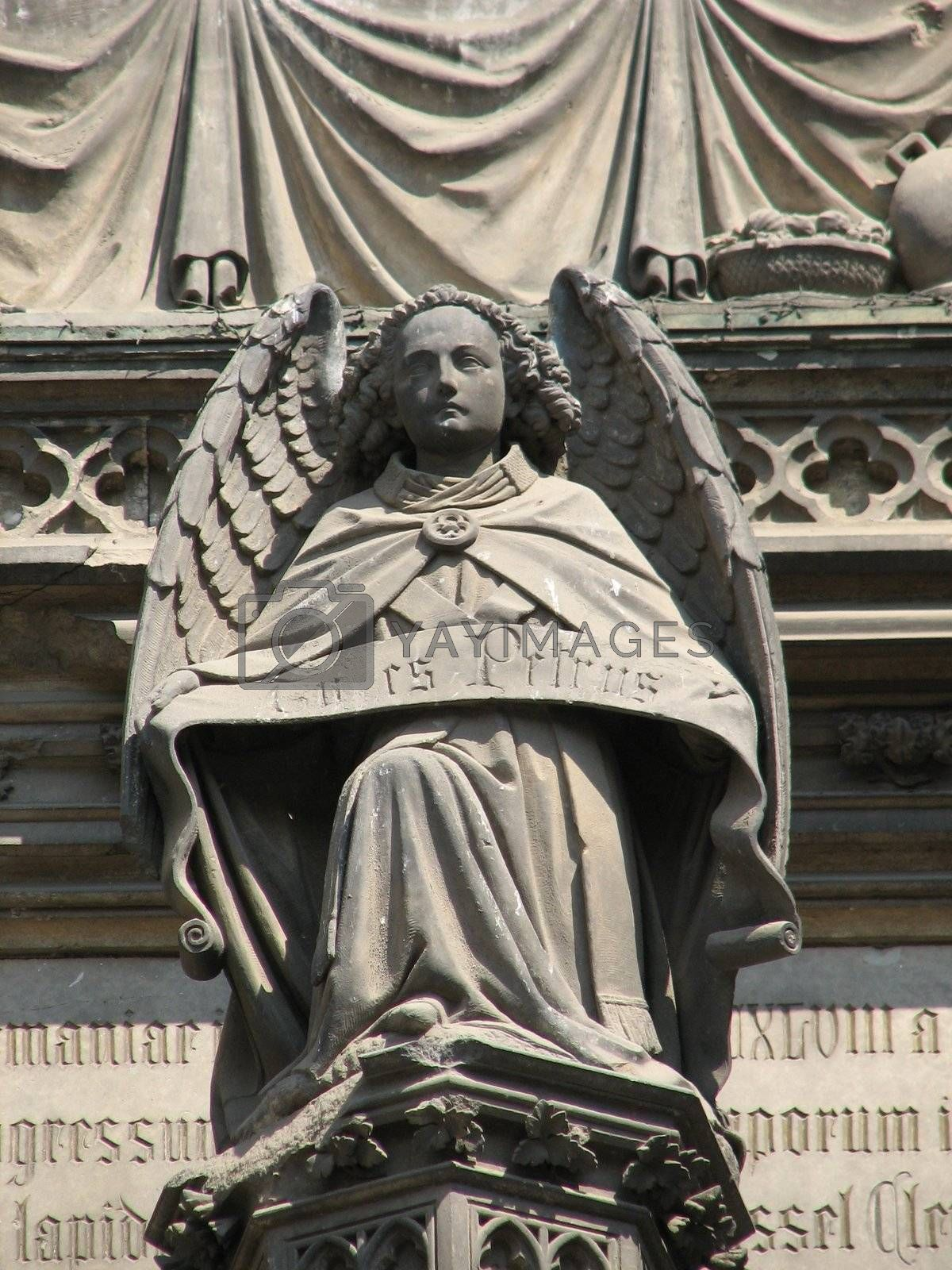 Stone angel at the main door portal of the cathedral at Cologne, Germany