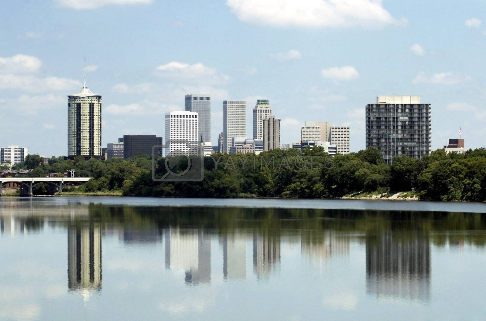 Skyline view of the city of Tulsa, Oklahoma with buildings reflected in the Arkansas River.