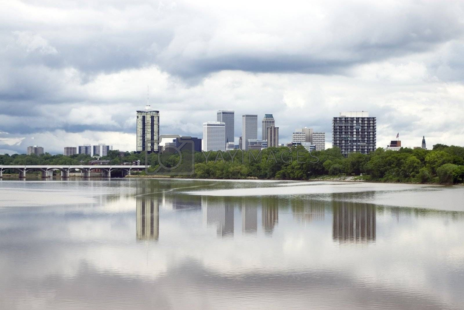 Stormy skyline of the city of Tulsa just before a severe spring storm, mirrored by its reflection in the Arkansas River.