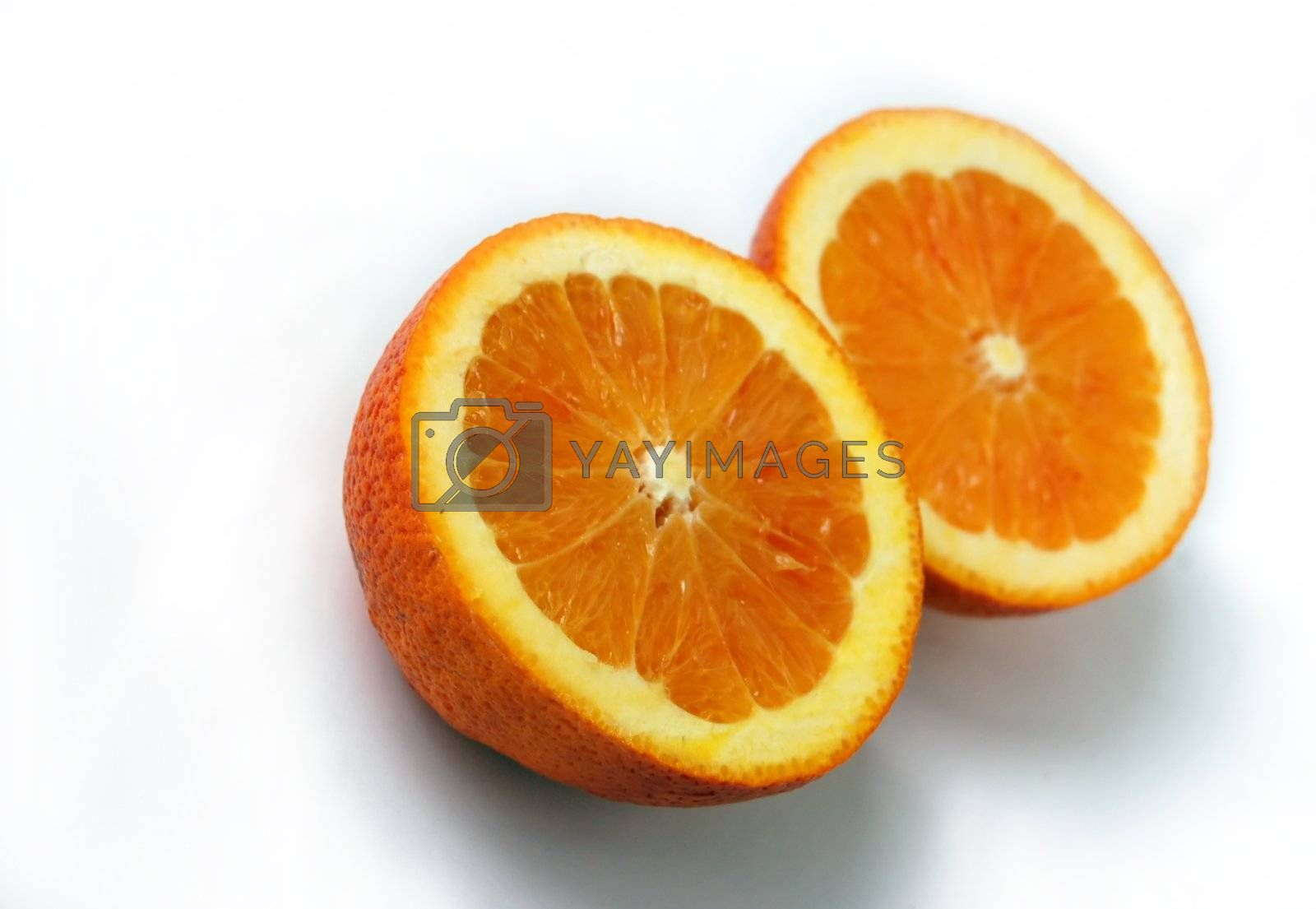 colored slices of orange with rough surface pattern isolated on white with shadows