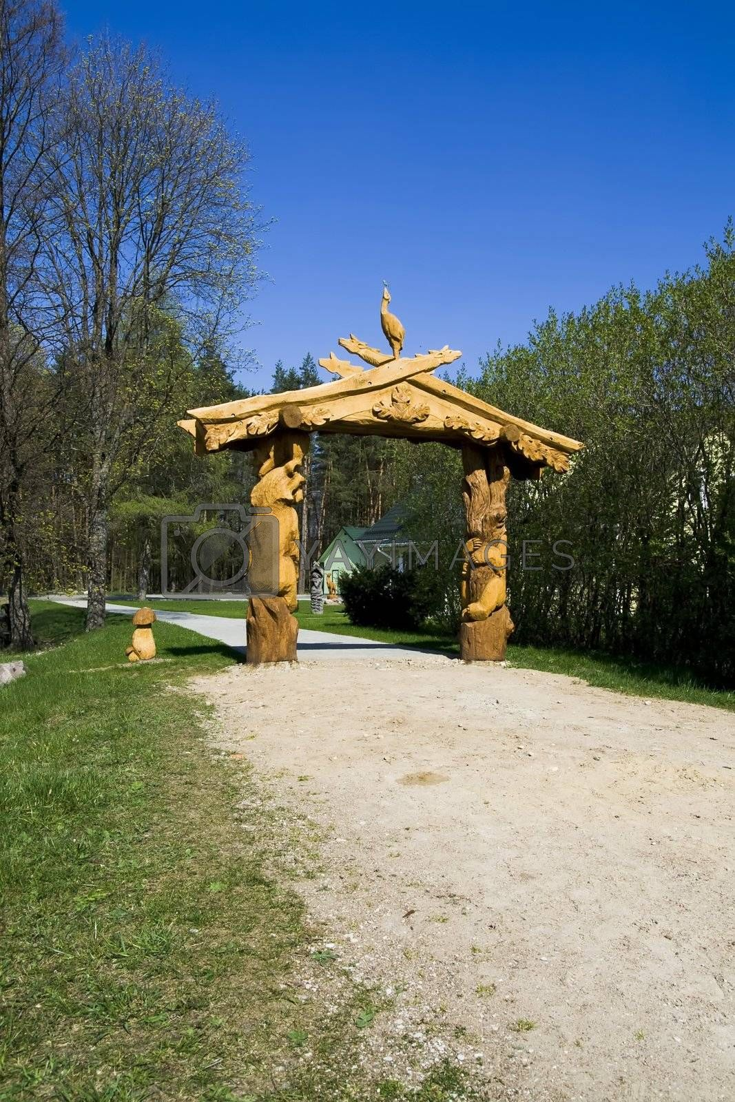 A wooden sculpture at the end of the path in the park