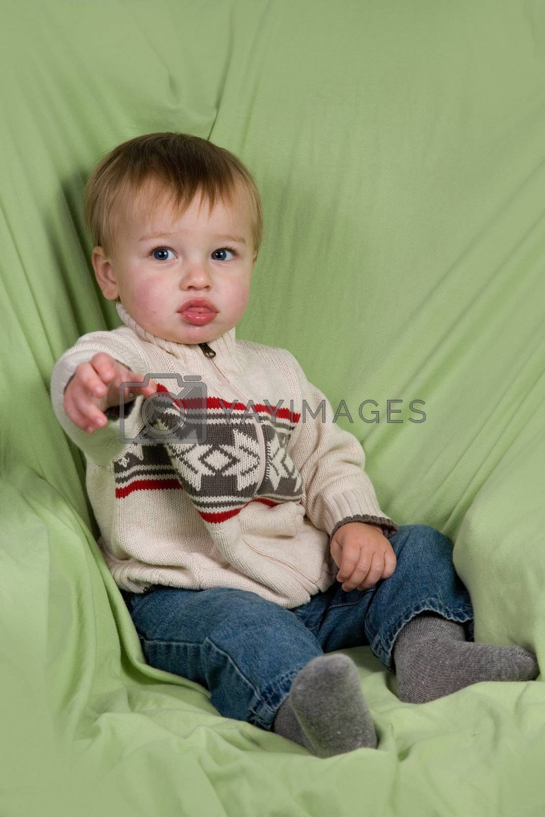 A portrait of a cute toddler dressed in winter clothes.