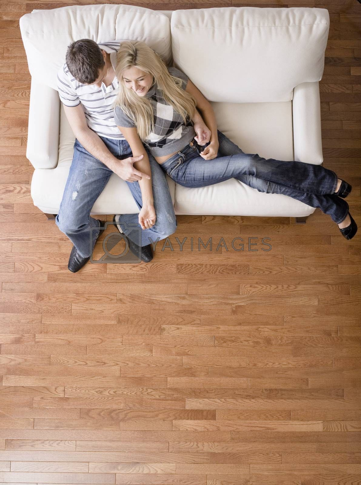 Overhead View of Couple on Love Seat by cardmaverick