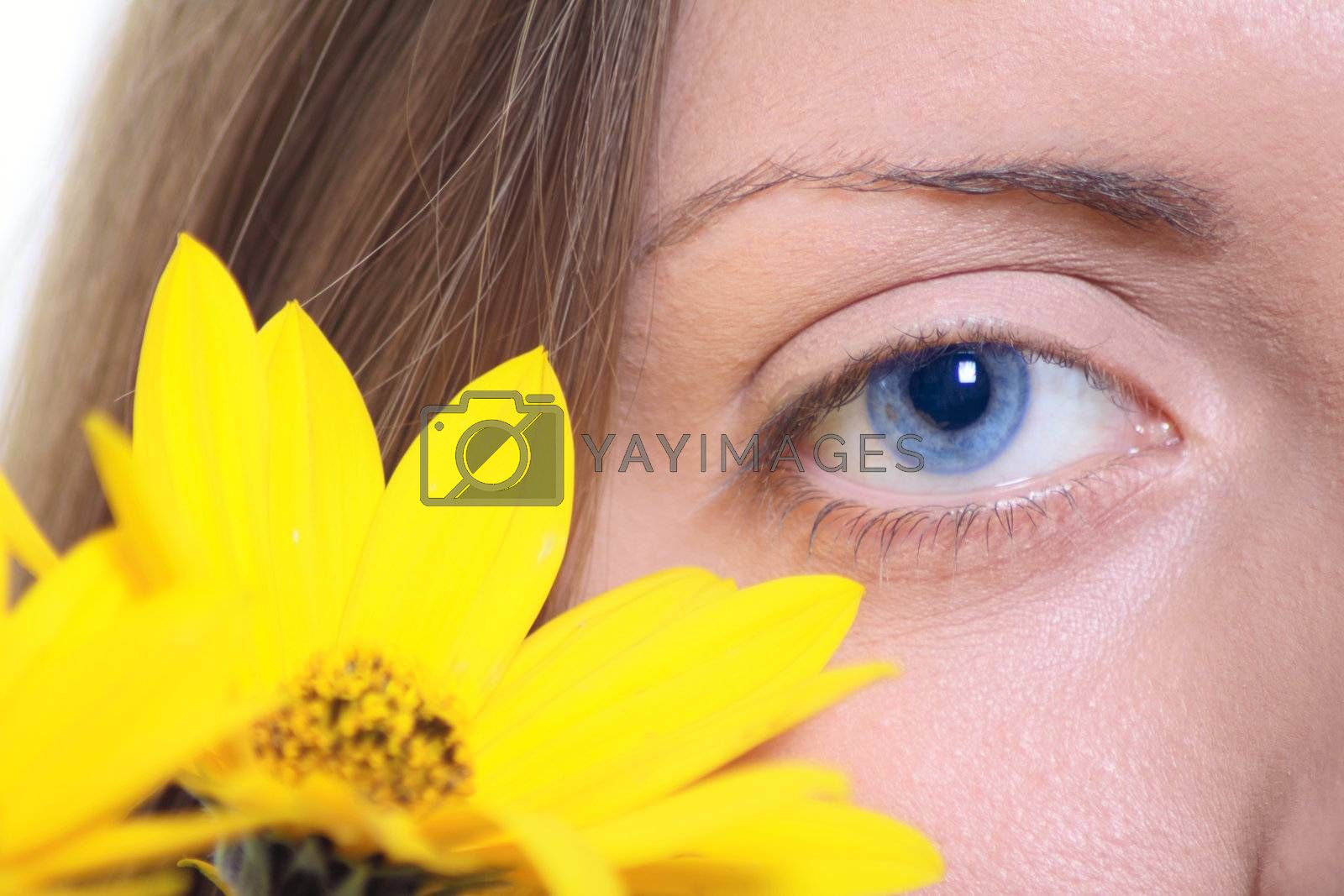 Female eye with a yellow flower by Incarnatus