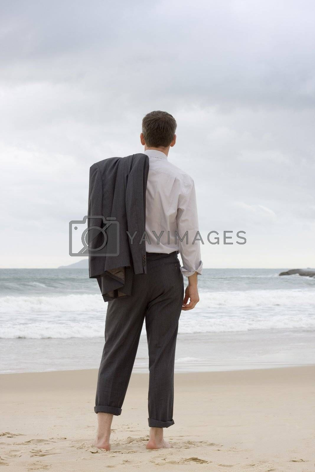 Barefoot businessman relaxing on a beach