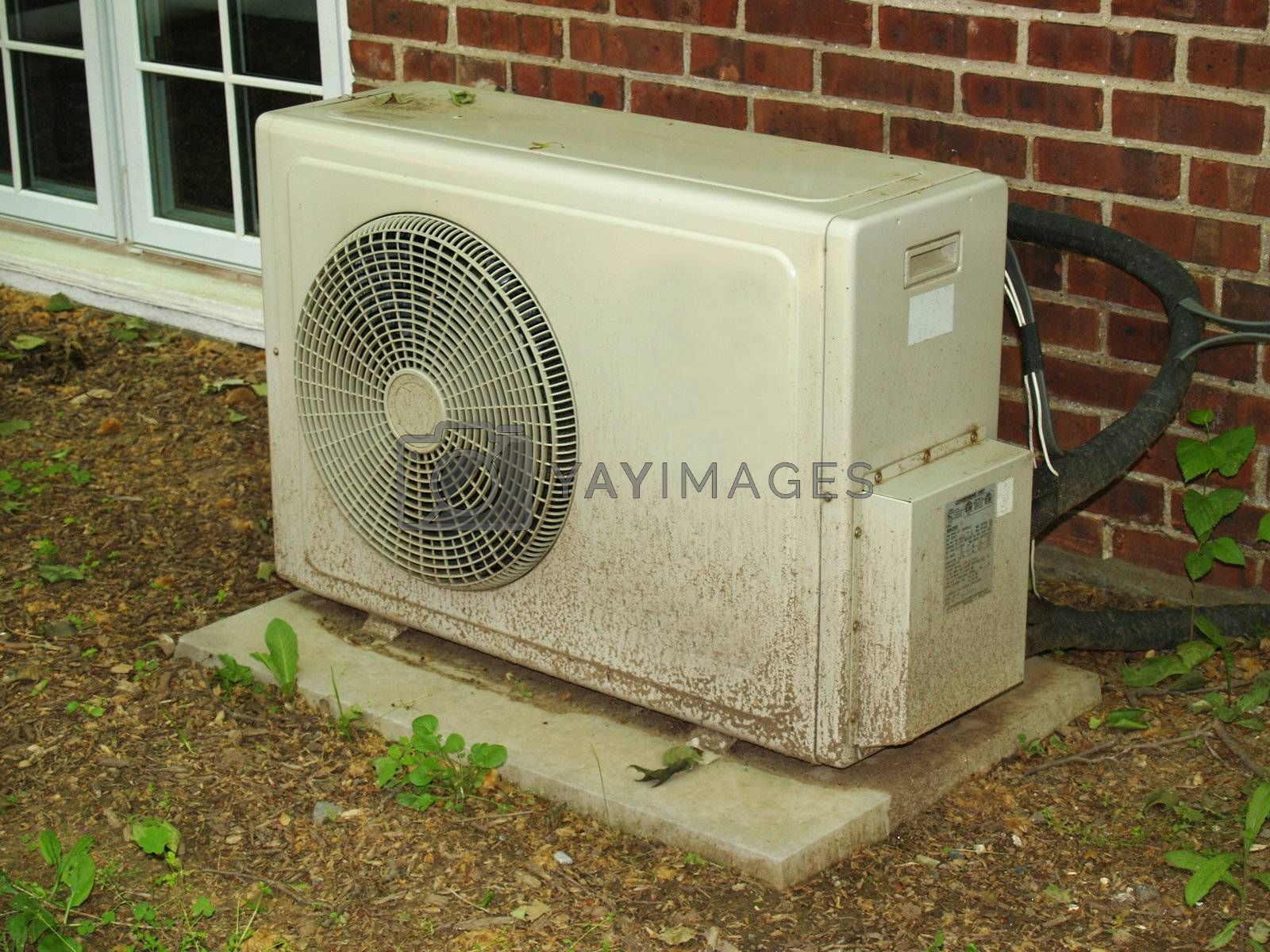 an outdoor air conditioning unit by a building