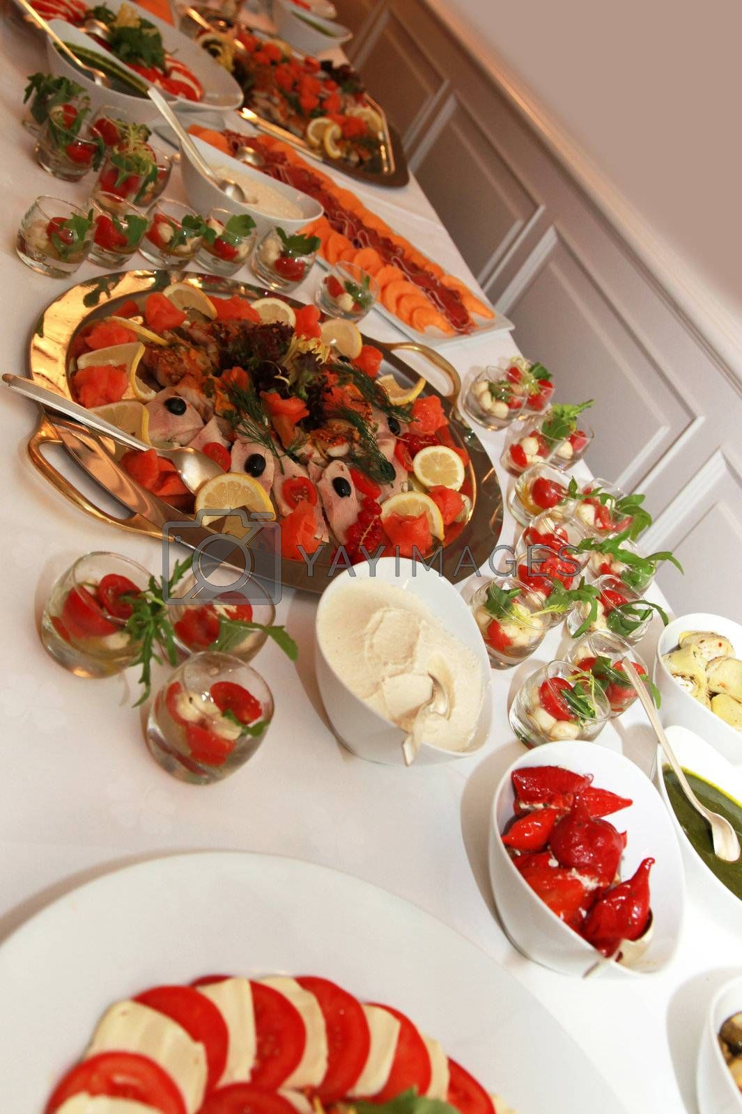 buffet with fish and tomato