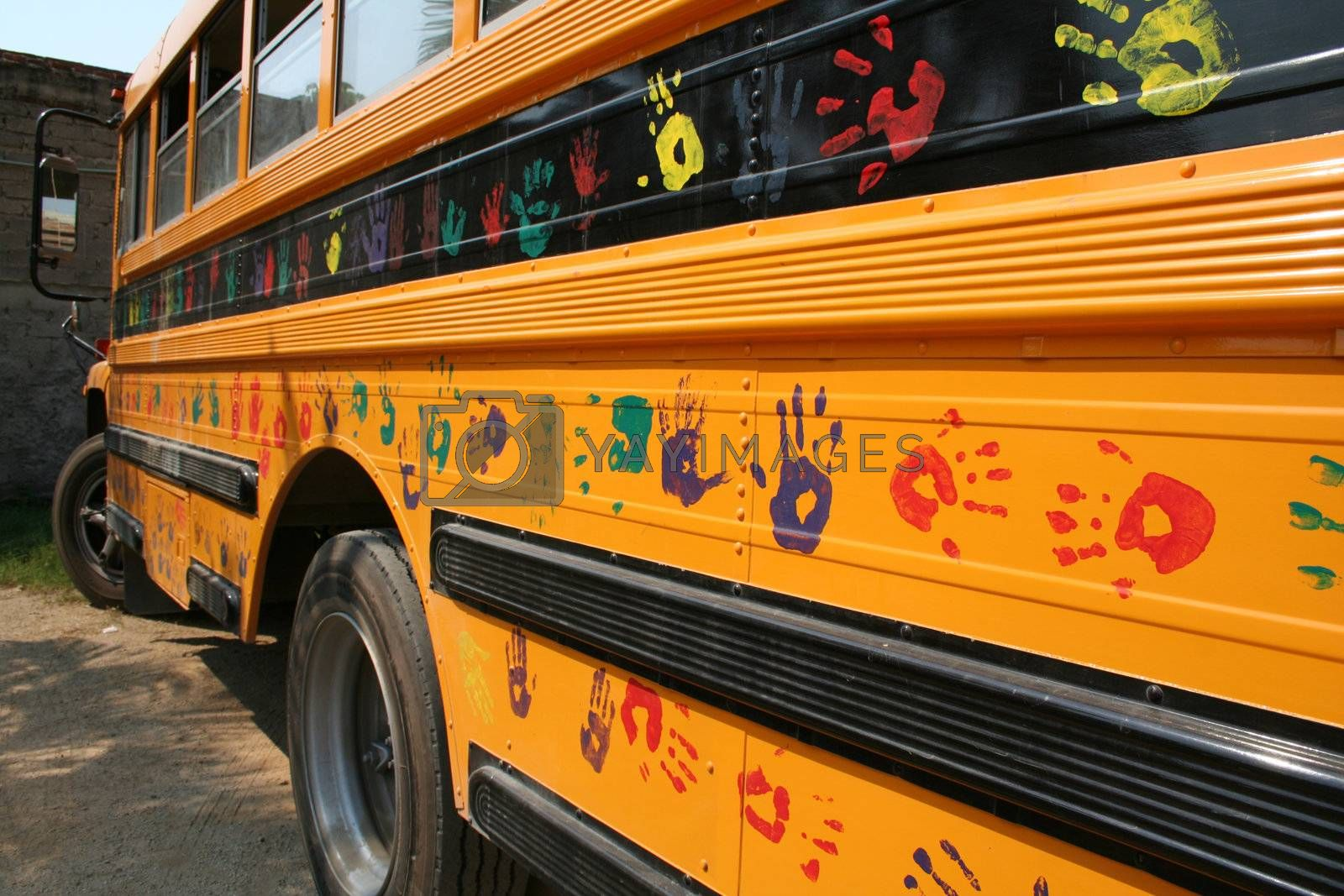 School bus with kids hands painted on the side