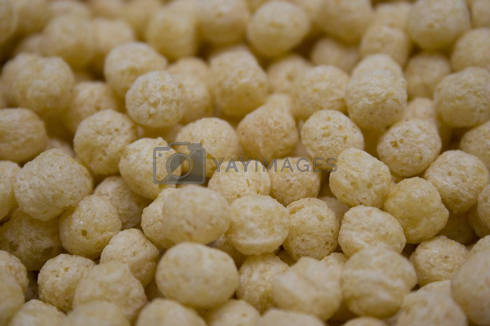 A close up shot of a bowl of puffed grain cereal.