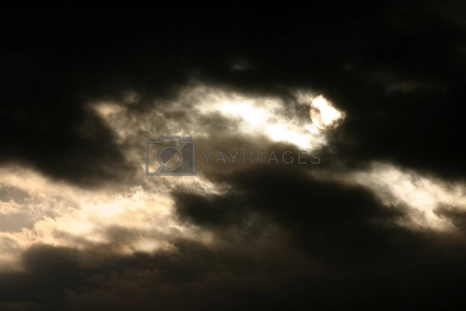 sun lurking behind story clouds