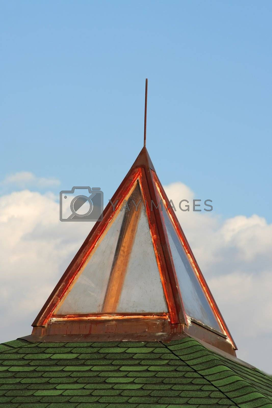 Glass pyramid on green roof