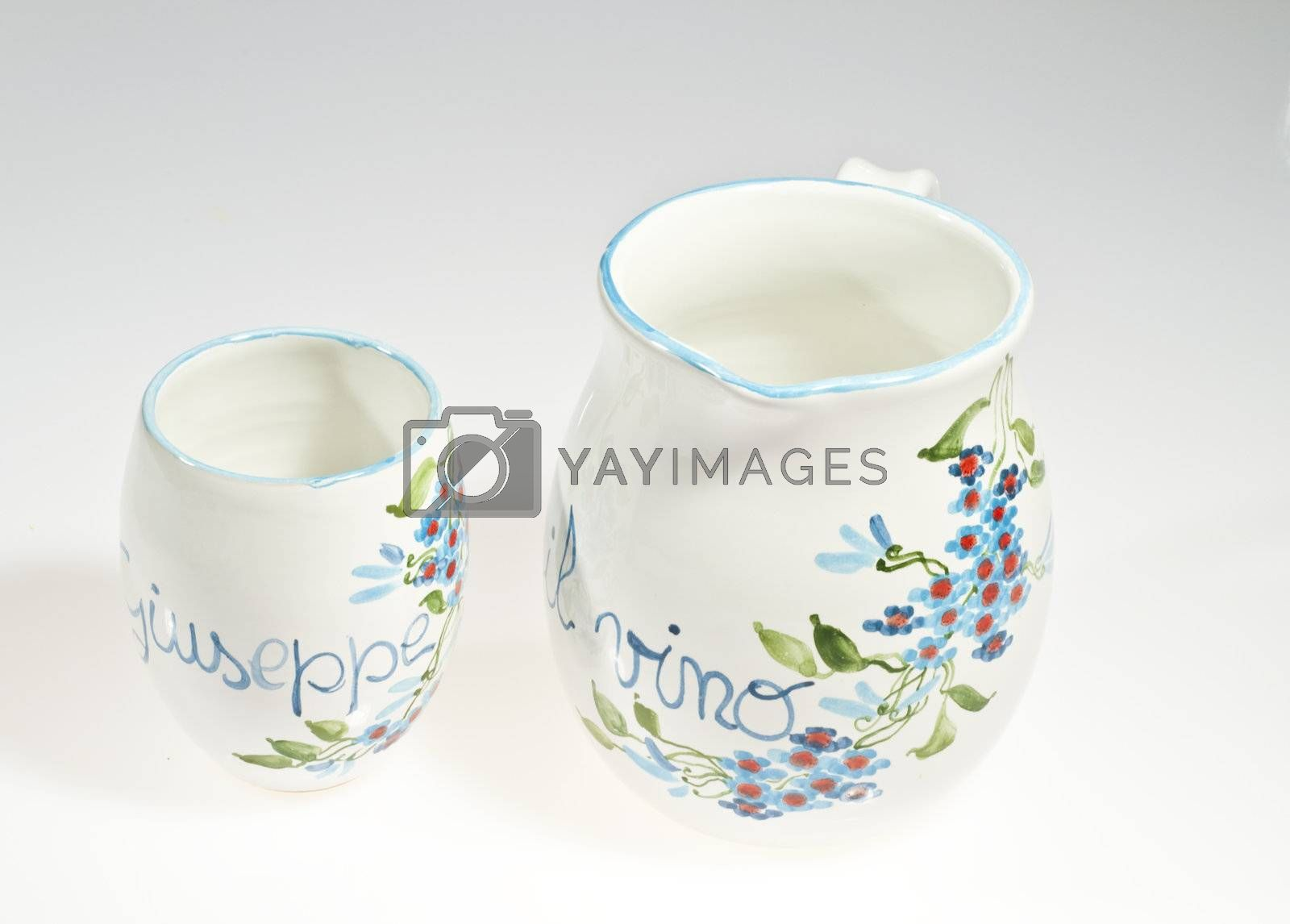 decorated pitcher and glasses on a white background