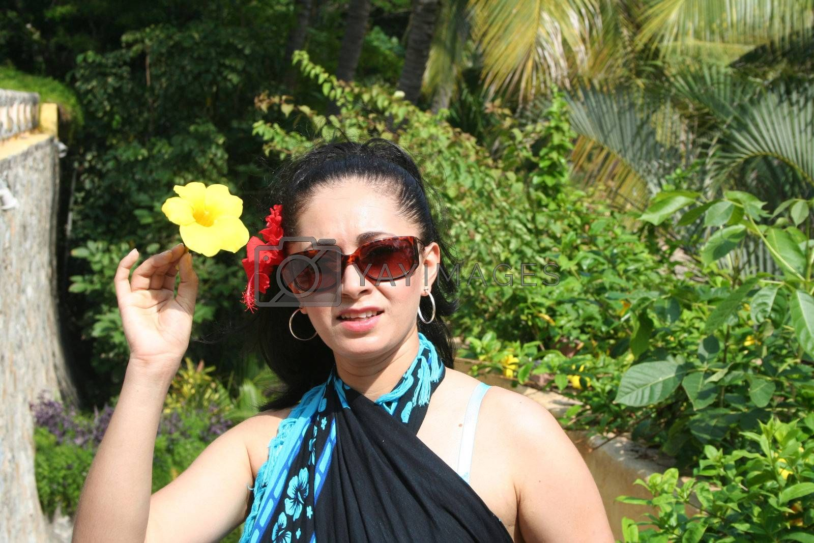 Young Latin woman at tropical setting