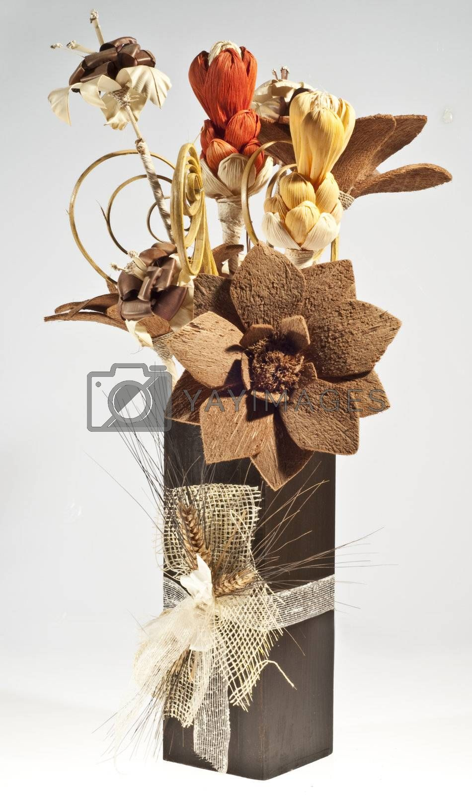cork and composition of flowers in a vase decorated with rice paper