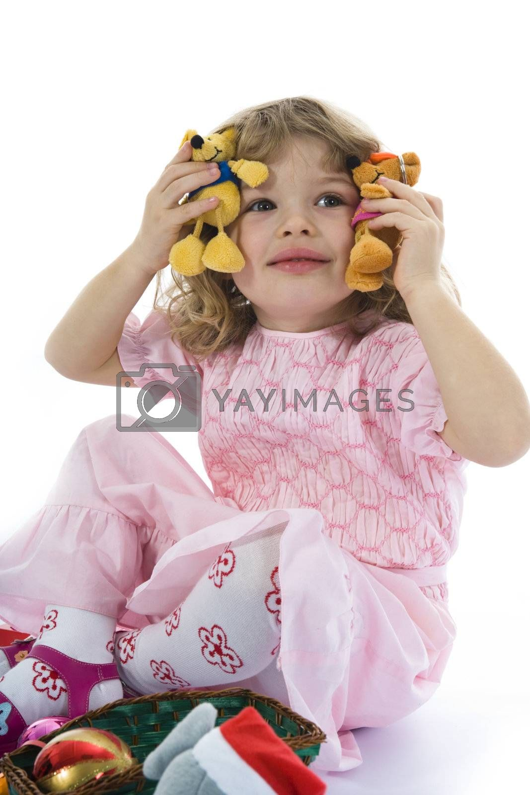 Beautiful little girl with christmas decoration on isolated background