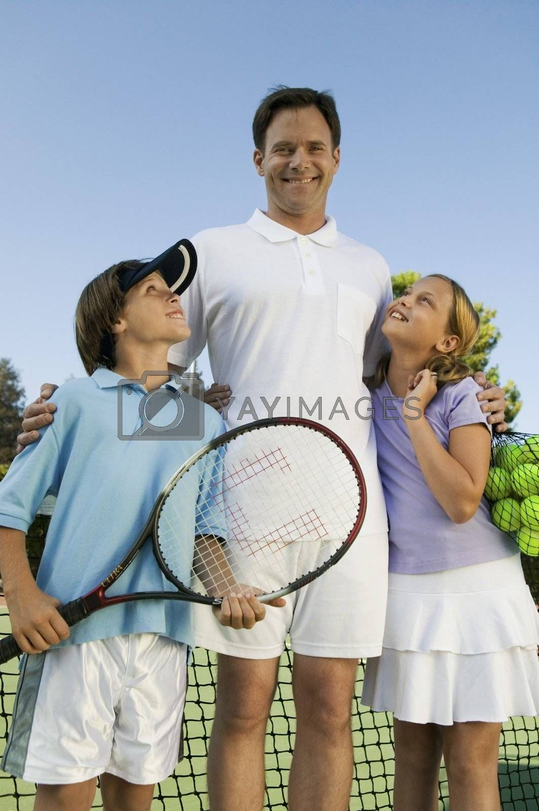 Father with Son and Daughter on Tennis Court