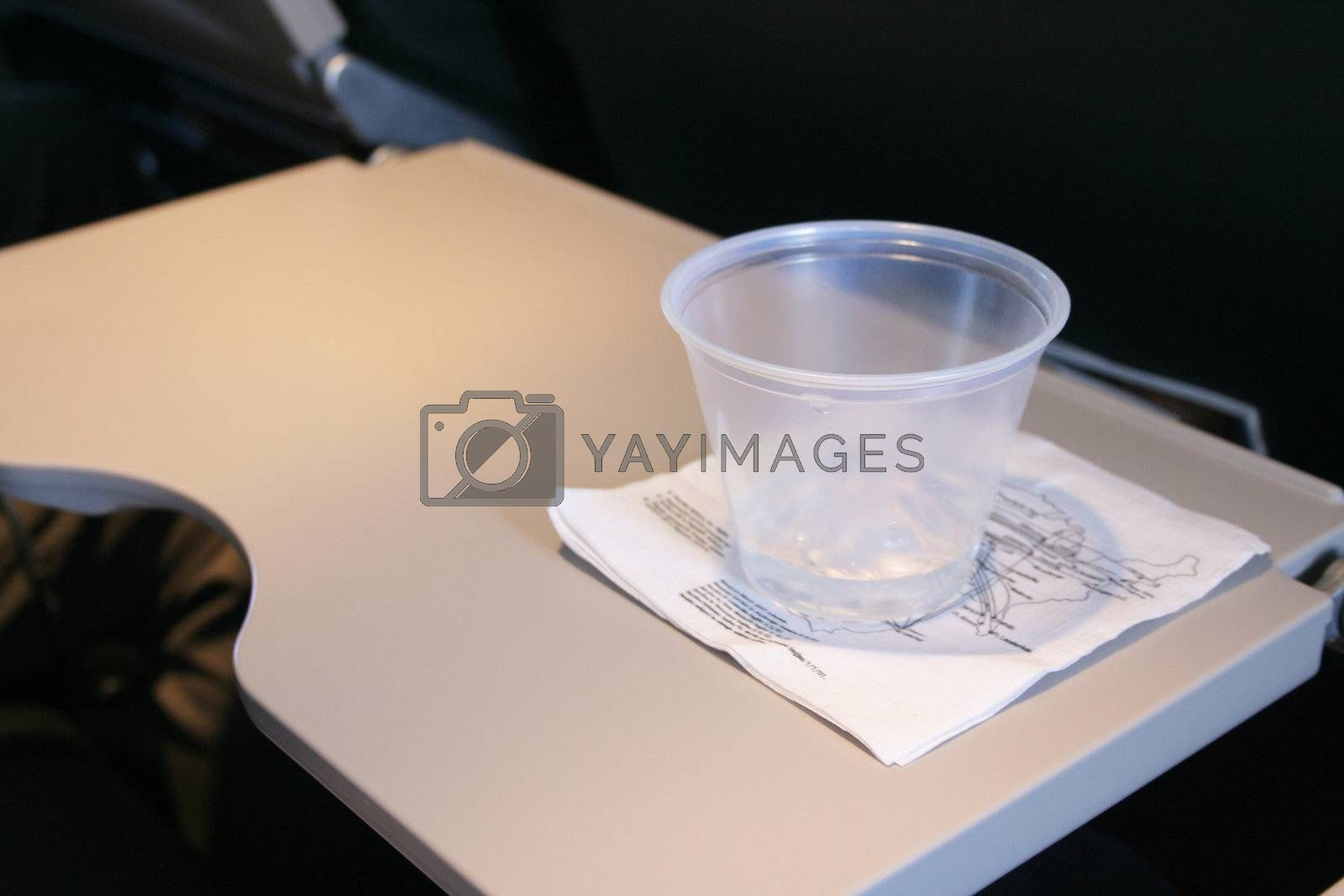 Food and snack tray open with drink on napkin