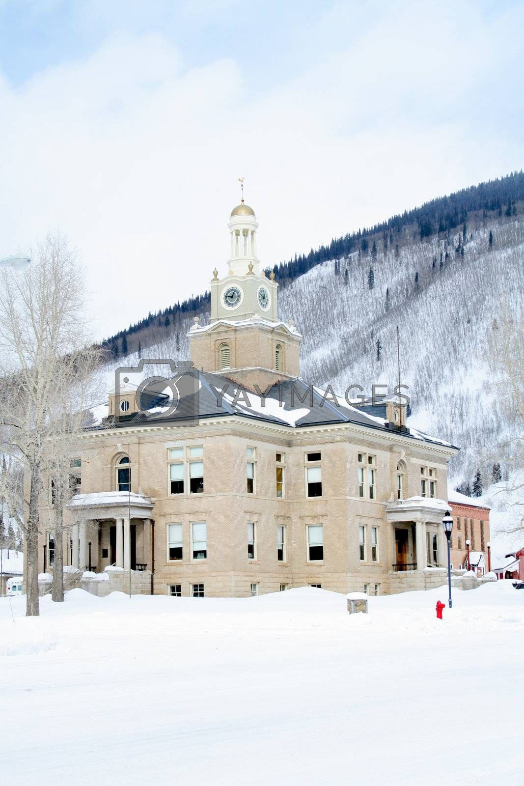 Old town hall in mountains with lots of snow