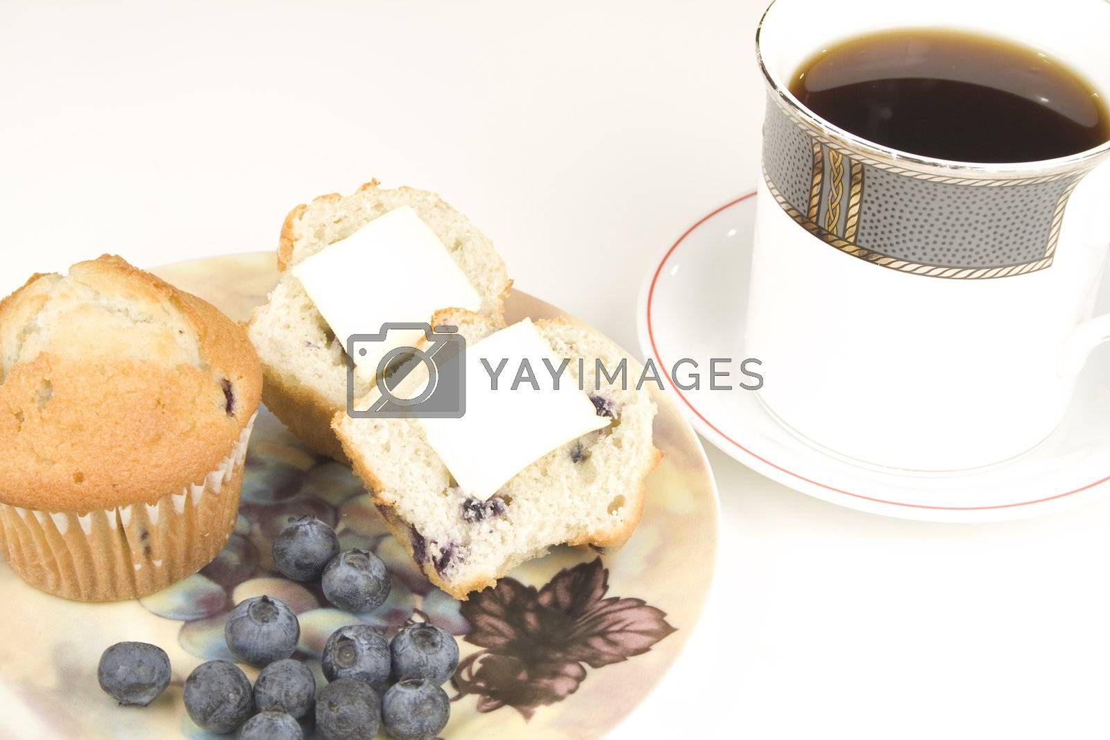 blueberry muffins with cup of coffee