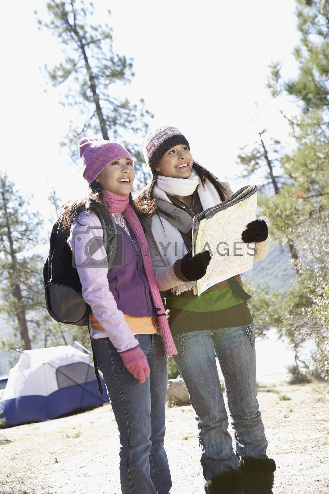 Two Young Women Camping and Holding Map
