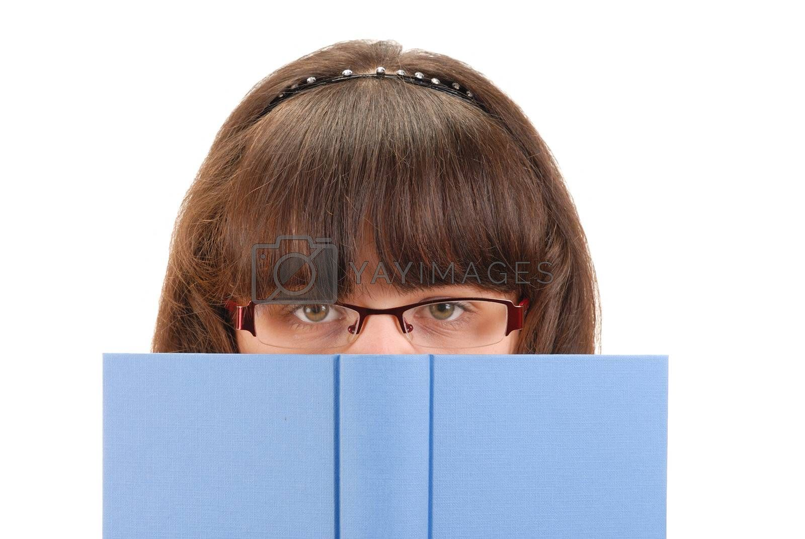 Teenage girl with book isolated on white