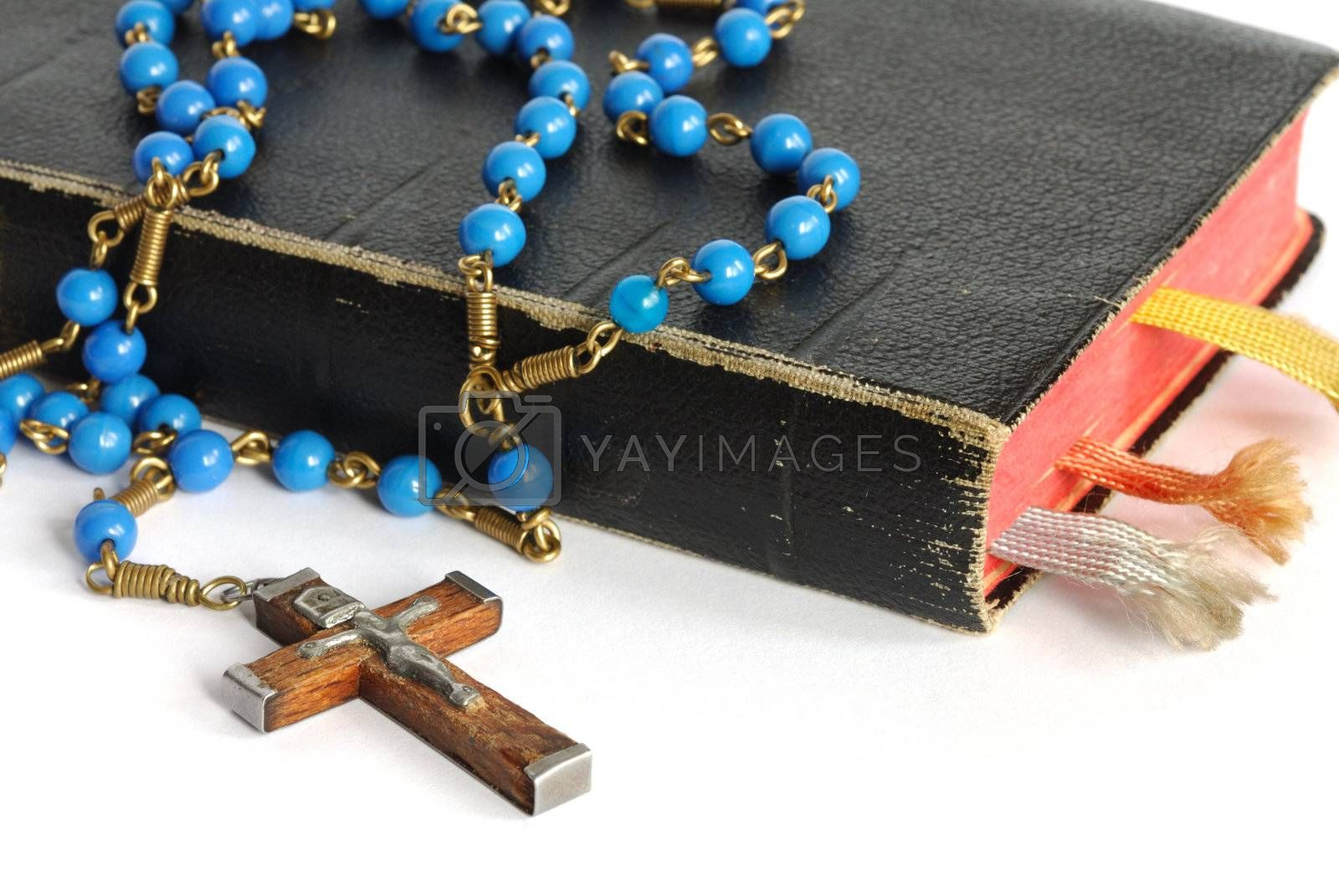 Old prayer book and rosary isolated on white