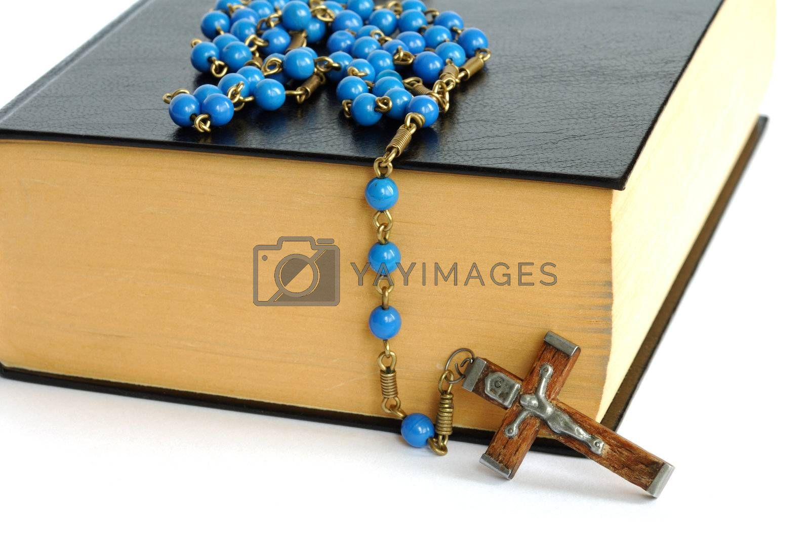 Holy bible and rosary isolated on white