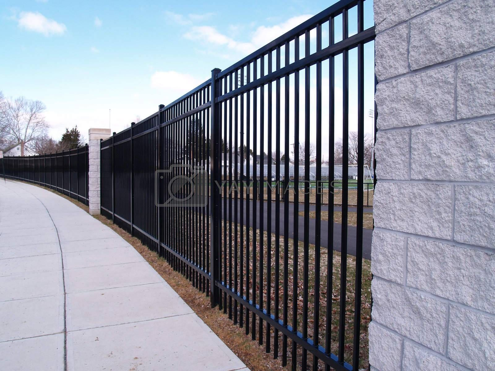 a view of a tall black fence