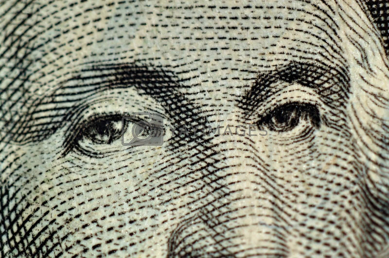Macro of dollar bill featuring the eyes of George Washington